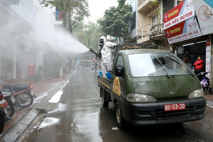 Chau Long Street, which connects with Truc Bach, was also sprayed with disinfectant.