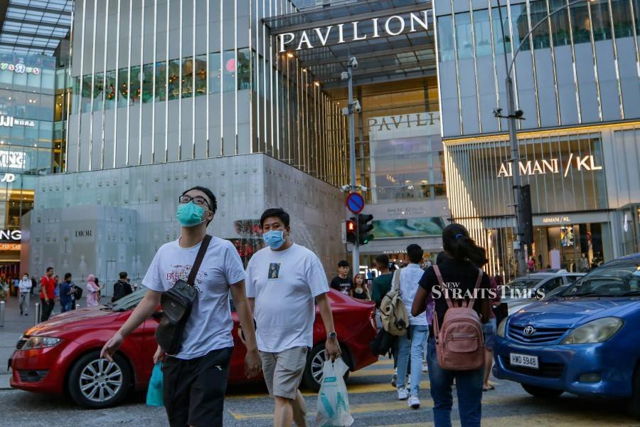 Members of the public seen wearing face mask outdoors amid the coronavirus outbreak.