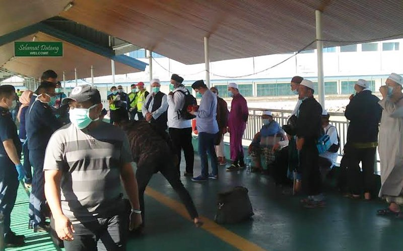 12 of the tabligh attendees arriving at the Tawau Customs, Immigration, and Quarantine Centre in Sabah after Indonesia cancelled the 'World Ijtima Asia Zone 2020' event in Sulawesi, Indonesia.