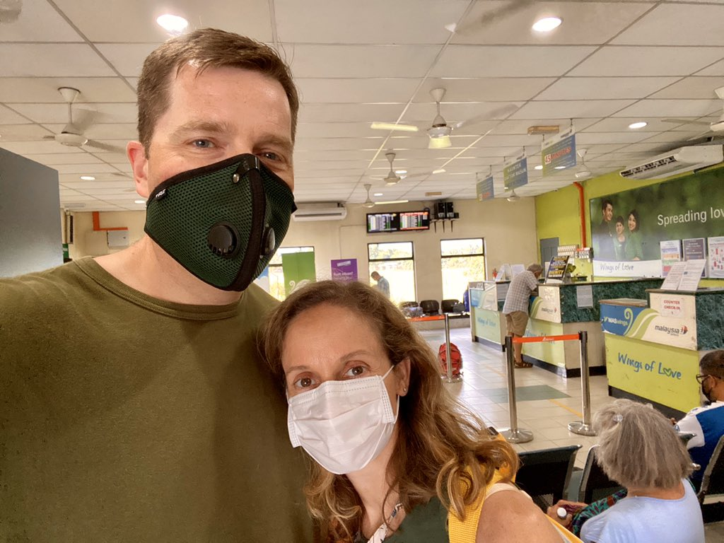Jason Hassenstab and his wife wearing face masks at the Lahad Datu airport in Sabah.