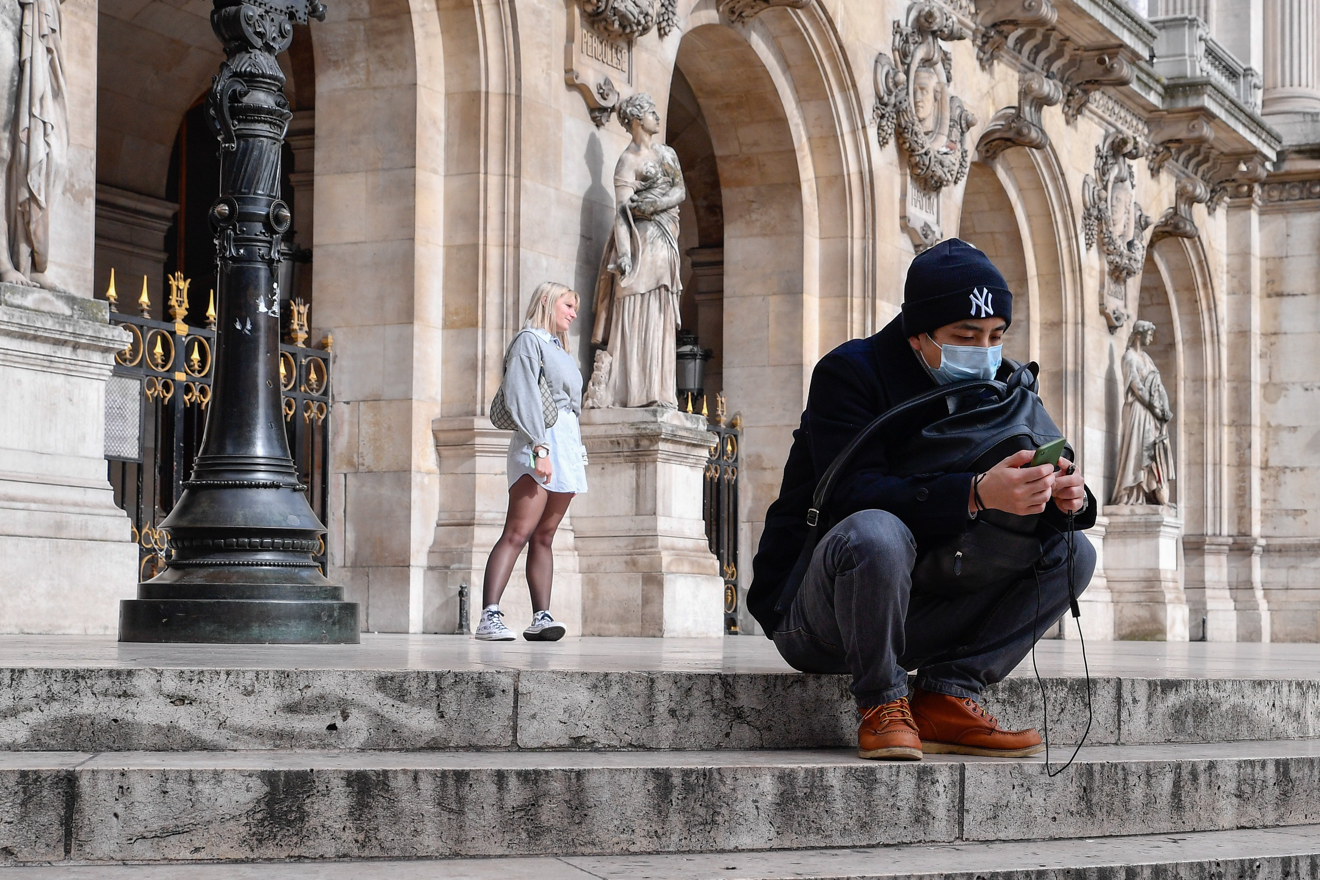 A man is seen wearing a mask in Paris on 3 March.