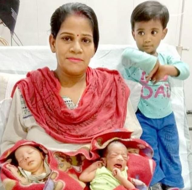 The mother pictured here with her newborn twins and two-year-old daughter.