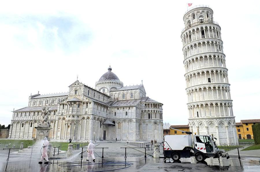 Local authorities disinfecting the area outside of the Leaning Tower of Pisa, Italy.