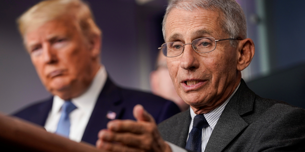 Dr Fauci speaks as US President Donald Trump listens during the daily COVID-19 press briefing at the White House.