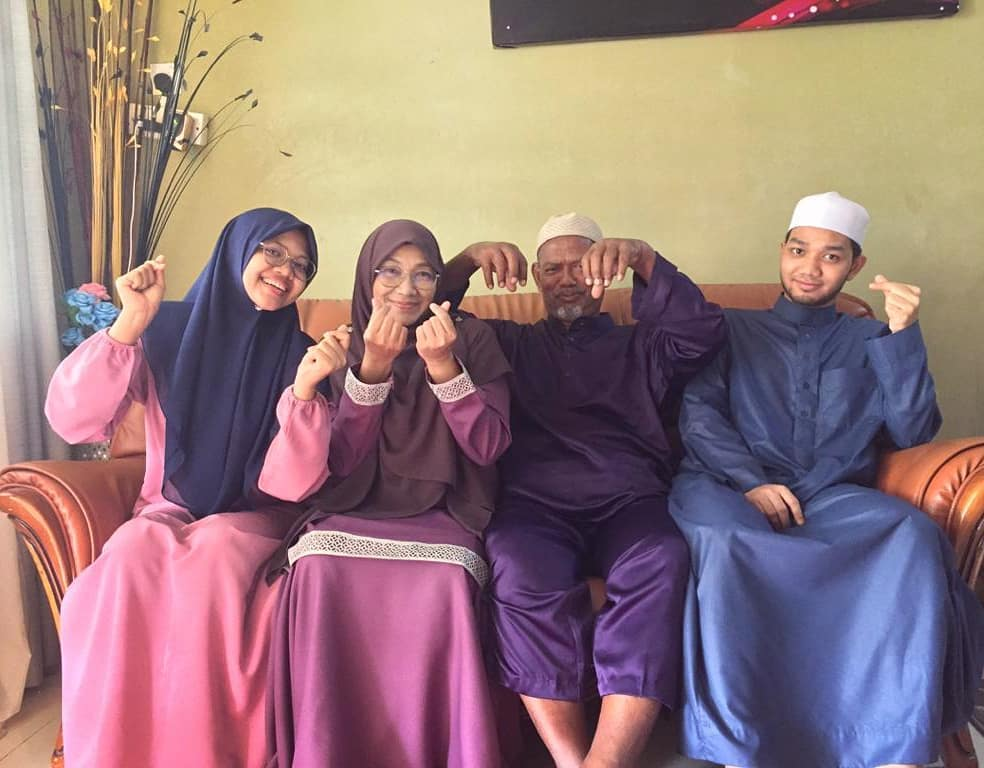 Haziq with his parents and older sister.