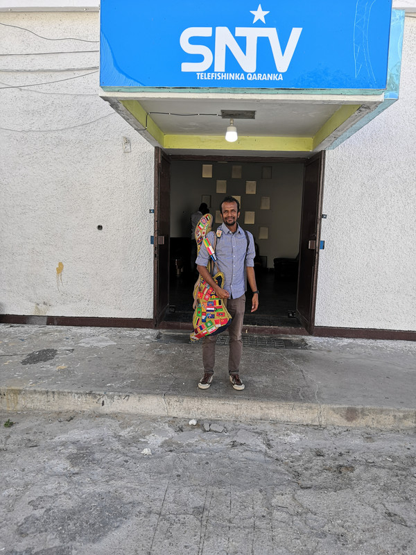 Jeshurun standing outside Somalia's national television station.