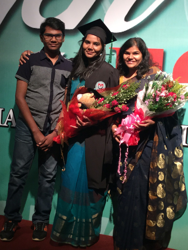 Yugendran (left) and his two elder sisters at one of their graduation ceremonies.