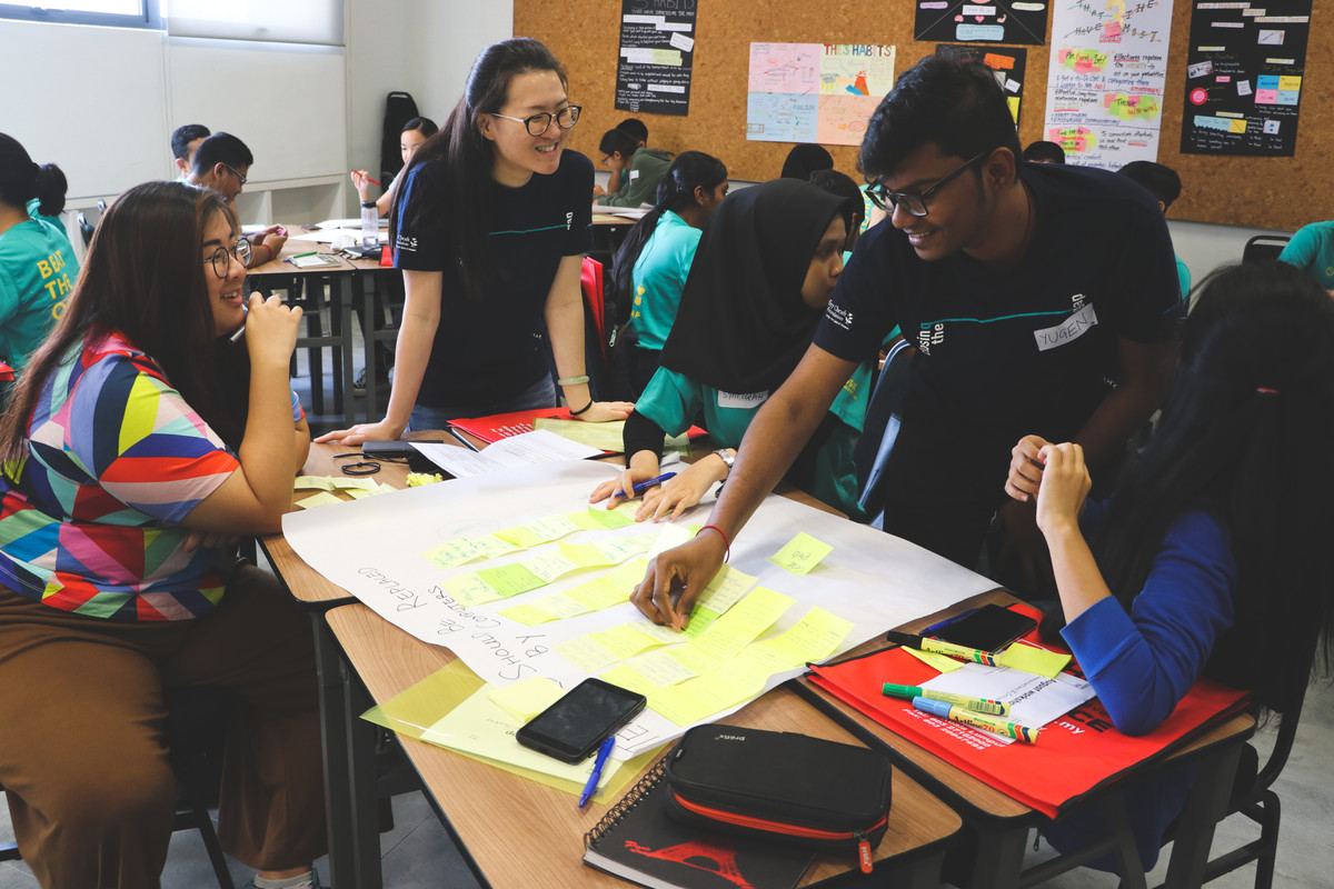 Yugendran working as part of a team with Closing The Gap, a Malaysian non-governmental organisation that empowers bright, under-represented students with the knowledge and skills to achieve their fullest potential.