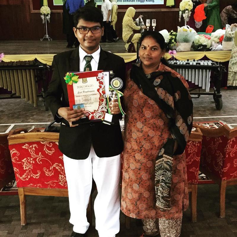 Yugendran (left) and his mother (right) at an awards ceremony held at his secondary school Sekolah Menengah Kebangsaan Tinggi Klang.