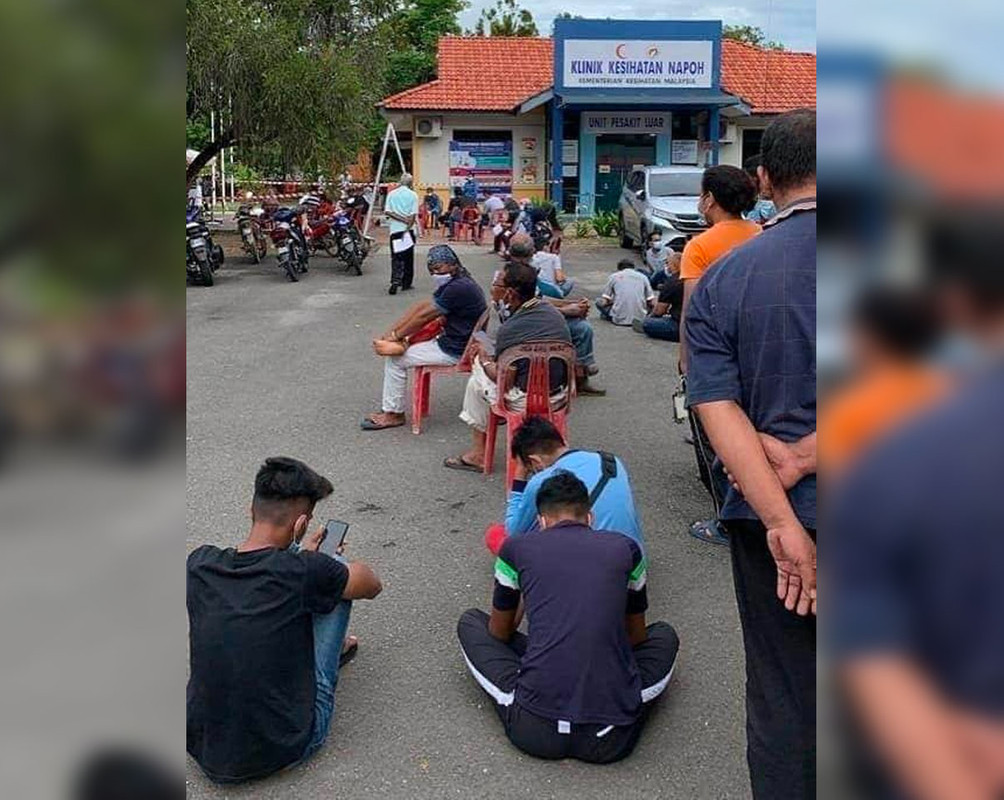 People queuing outside a government clinic in Napoh in Jitra, Kedah.