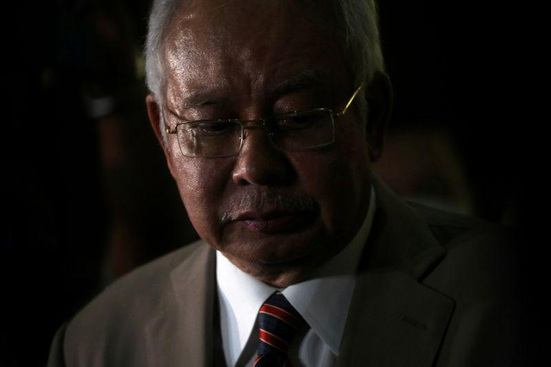 A convicted Najib during a news conference outside Kuala Lumpur High Court on 28 July.