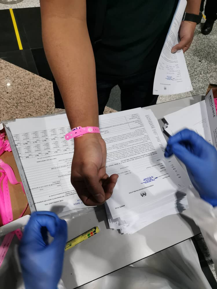 An example of the pink wristbands issued by the MOH to identify PUS for 14 days.