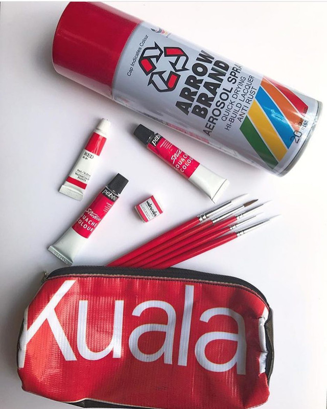 A pouch made from advertisement banners.
