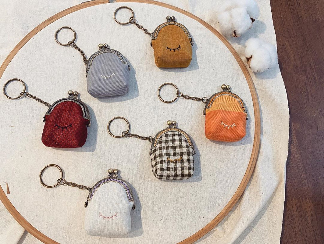 Mini clasp purse keychains with embroideries.