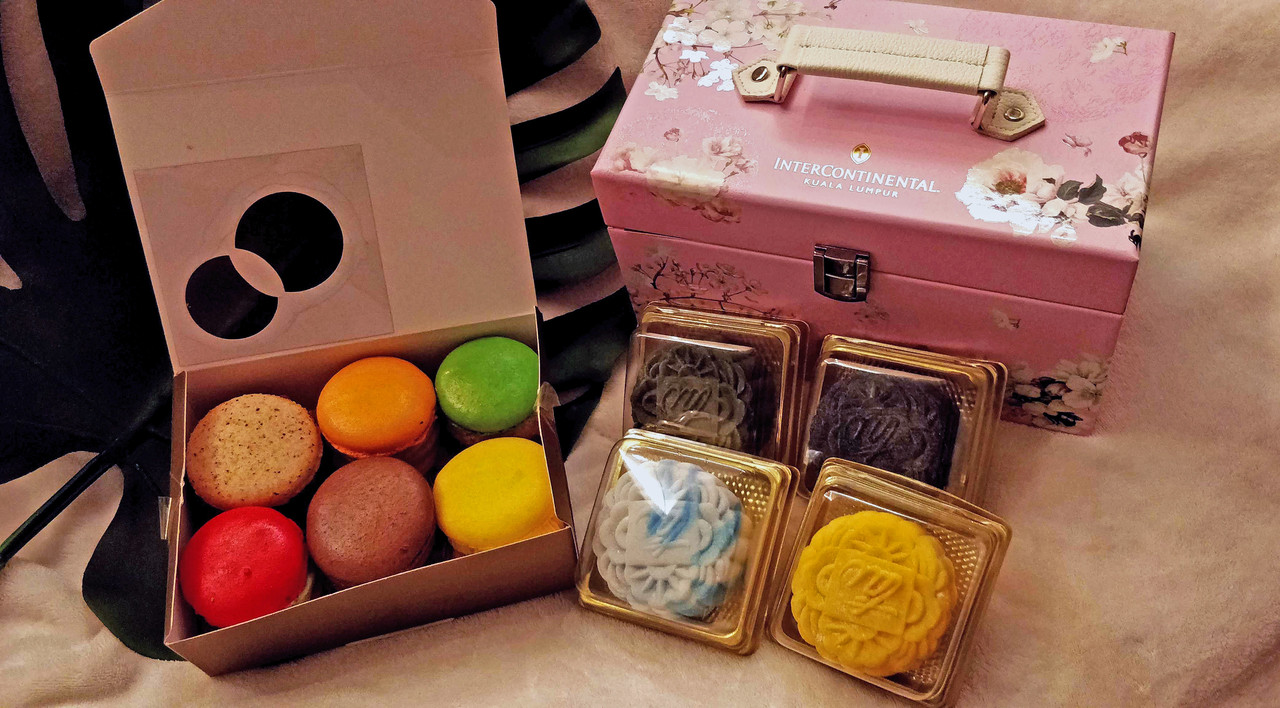Along with its mooncakes, InterContinental also released 'Fat-carons' – South Korean super-sized macarons (pictured on the left).