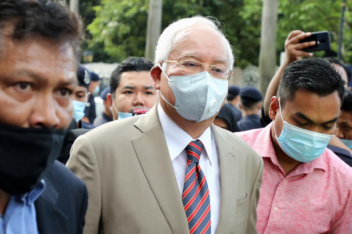 Najib leaving the KL High Court on 28 July after being sentenced to 12 years' jail, but was given a stay of execution of his sentence pending the appeal.