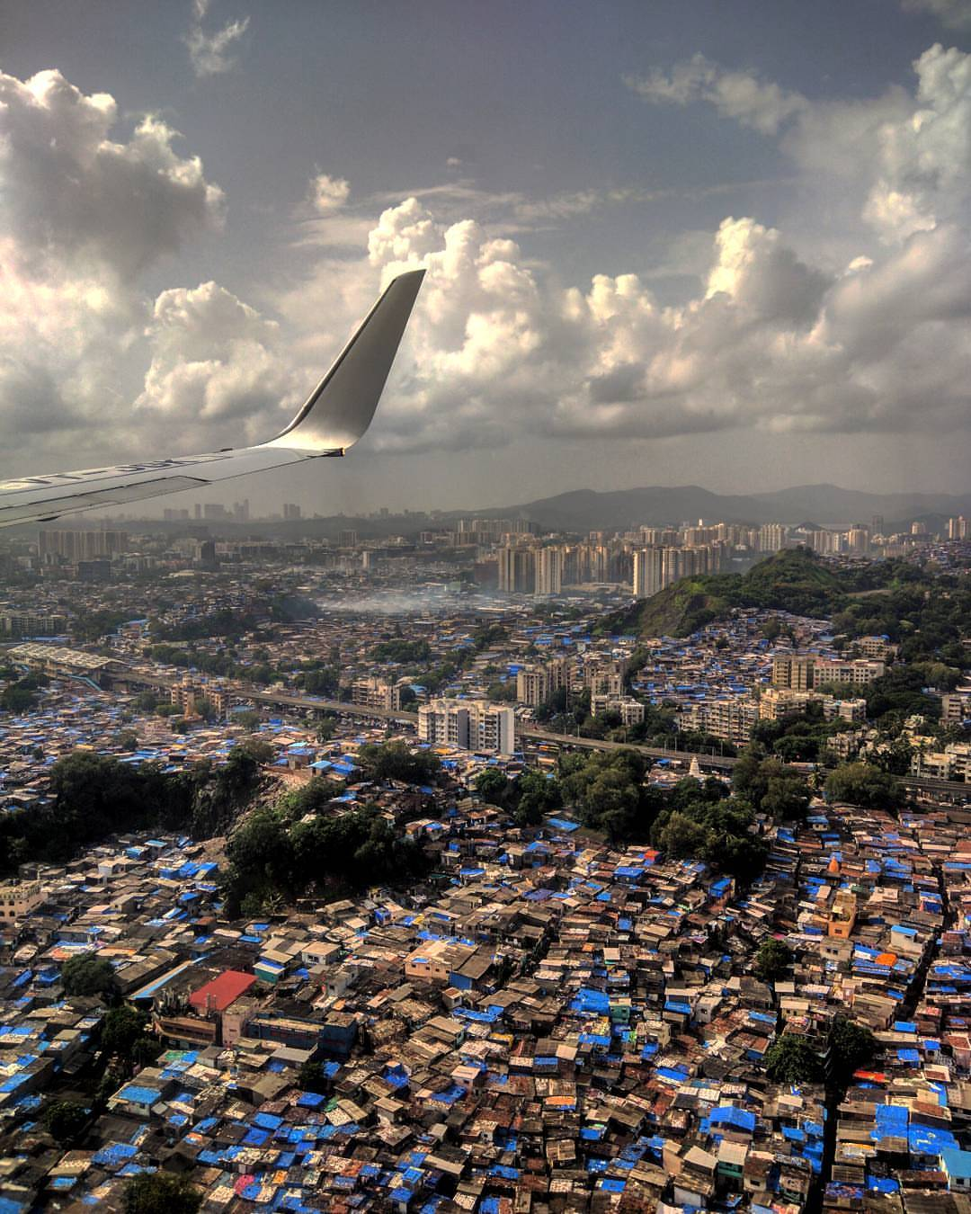 I took this shot back in 2017 during the monsoon season. My favourite thing about this photo is the surrealism embedded in the view overlooking the tarpaulin-covered houses in Bombay, where lies one of Asia's largest slums.